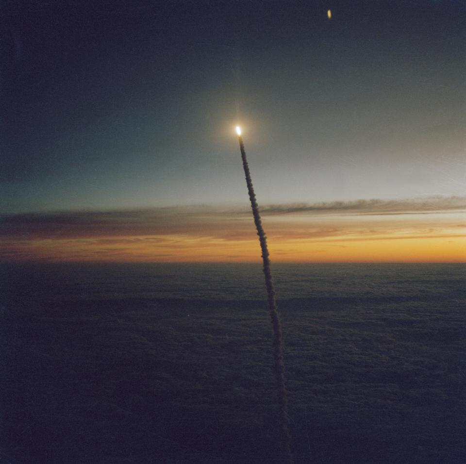 The Space Shuttle Challenger launches from Florida at dawn