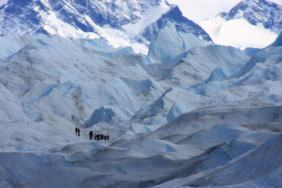 a group of trekking tour on a huge glacier ice in patagonia
