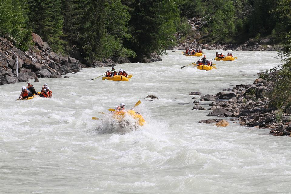 Group of adventurers in an inflatable dinghy in the white water