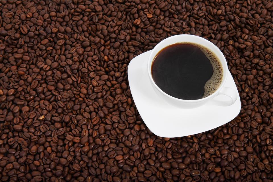 Cup of coffee with coffee bean